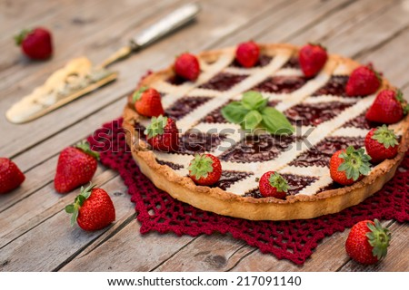 Fruit tart with strawberry filling and fresh strawberry - stock photo