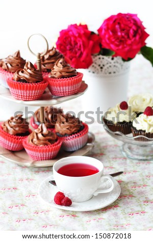 Fruit tea and chocolate cupcakes - stock photo
