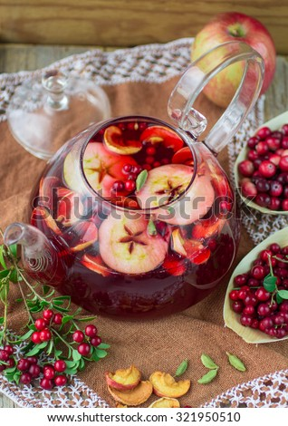 Fruit tea from apples, cranberries, cowberry  and cardamom. Hot Christmas drink - stock photo