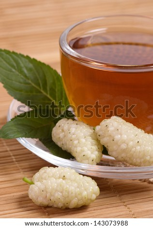 Fruit tea in cup with berry - stock photo