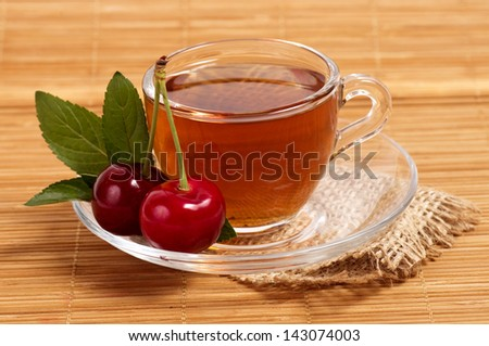 Fruit tea in cup with berry