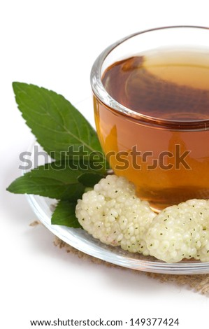 Fruit tea in cup with mulberry - stock photo