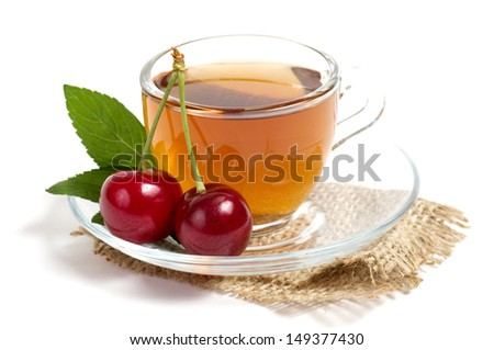 Fruit tea in cup with red cherry - stock photo