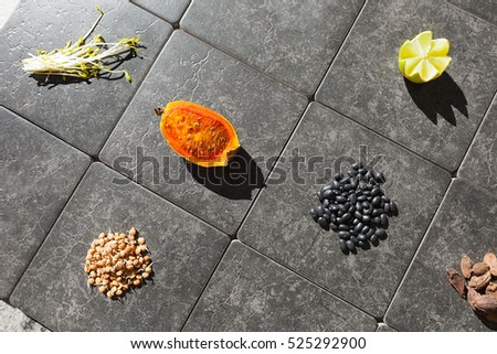 Fruit, vegetables and legumes on tiles