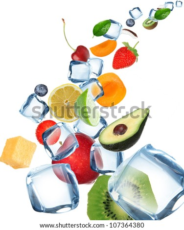 Fruit with ice cubes in motion - stock photo