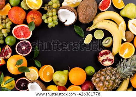 fruit with leaves on a black background - stock photo