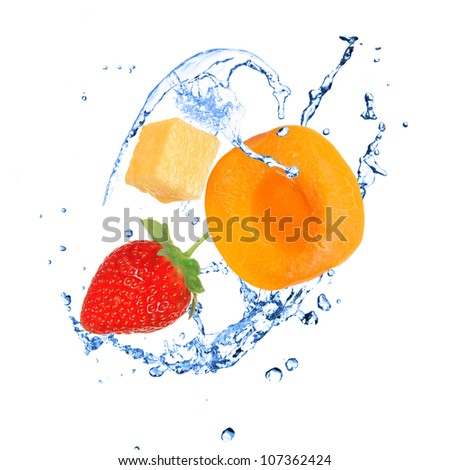 Fruit with water splash over white - stock photo