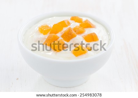fruit yogurt in a white bowl, close-up - stock photo