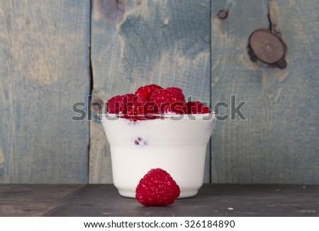 fruit yogurt with raspberry - stock photo