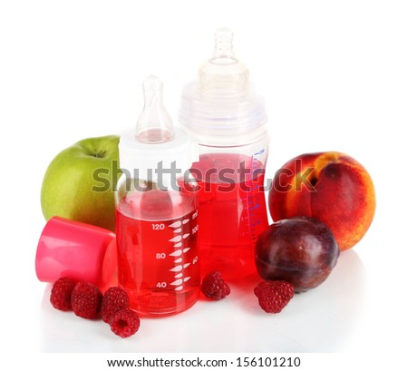 Fruits and baby bottles with compote isolated on white - stock photo