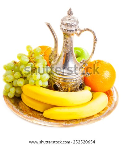 Fruits and  jar on a plate - stock photo