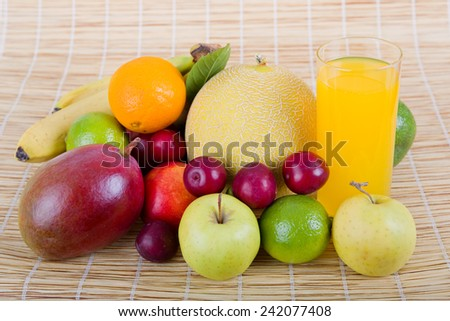 fruits and juice in a wooden table - stock photo