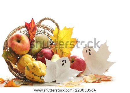 fruits and pumpkins in basket with autumn leaves - stock photo