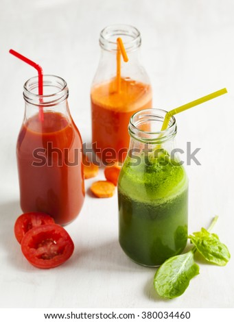 Fruits and vegetable juice in bottle: Apple and spinach juice, Carrot juice and Tomato juice - stock photo