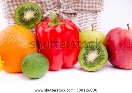 fruits and vegetables around basket