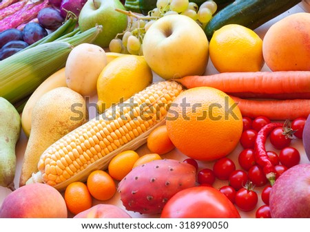 Fruits and vegetables arranged in rainbow colors - stock photo