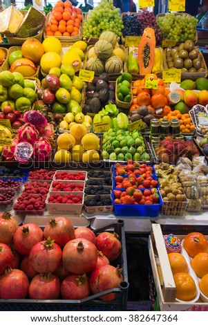 Fruits and vegetables at a farmers market.  Market stall with variety of organic vegetable - stock photo