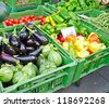 Fruits and vegetables at market stall - stock photo