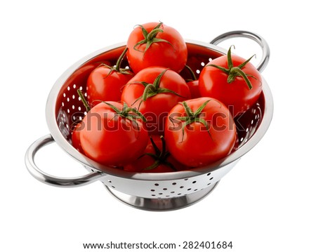 Fruits and vegetables: fresh red tomatoes in a steel colander, isolated on white background - stock photo