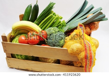 Fruits and vegetables in a wooden box