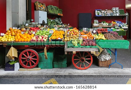 Fruits and vegetables in cart at market - stock photo