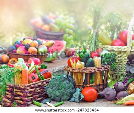 Fruits and vegetables in wicker baskets - stock photo