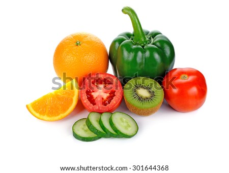 Fruits and vegetables like tomatoes, sweet pepper, oranges and cucamber arranged in a group, natural still life for healthy food - stock photo