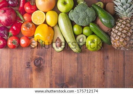 fruits and vegetables on background wooden table - stock photo