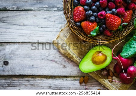 Fruits and vegetables on rustic background - stock photo