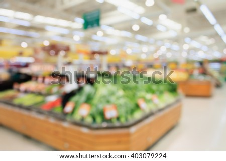 Fruits and vegetables on shelves in supermarket blur background - stock photo