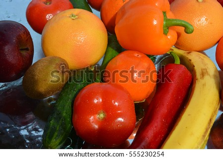 Fruits and vegetables on water background