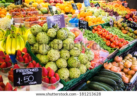 Fruits and vegetables stall in La Boqueria, the most famous market in Barcelona.