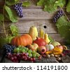 Fruits and vegetables with pumpkins in autumn still life - stock photo