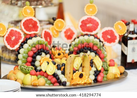 Fruits arranged in the form of a swan served for a dinner table - stock photo