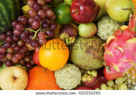Fruits background, many fresh fruits mixed together
