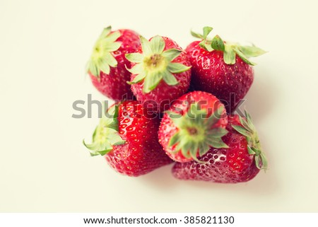 fruits, berries, diet, eco food and objects concept - juicy fresh ripe red strawberries on white - stock photo