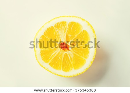 fruits, citrus, diet and objects concept - ripe orange or lemon slice over white - stock photo