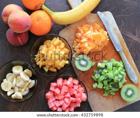 Fruits cutted on a wooden board - stock photo