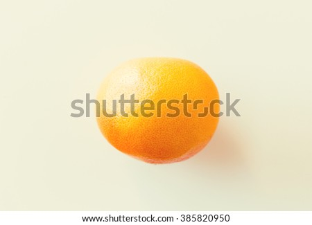 fruits, diet and objects concept - ripe grapefruit over white - stock photo
