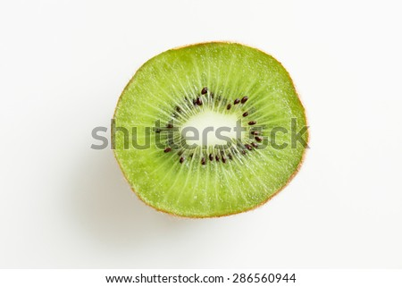 fruits, diet, food and objects concept - close up of ripe kiwi slice on table - stock photo