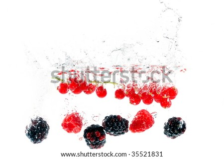fruits falling in the water - stock photo
