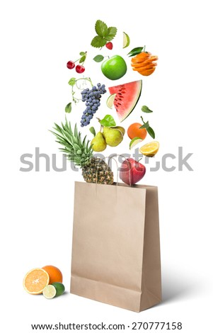 Fruits falling into bag isolated on white background. Healthy eating concept - stock photo