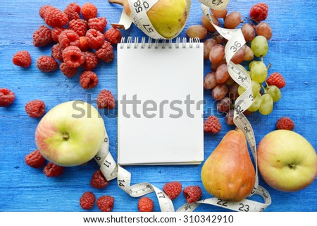 fruits for weight loss, a measuring tape, diet, weight loss, healthy eating, healthy lifestyle concept - stock photo