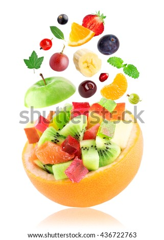 Fruits. Fruit salad in bowl on white background