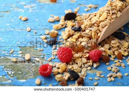 Fruits granola on blue background, food closeup