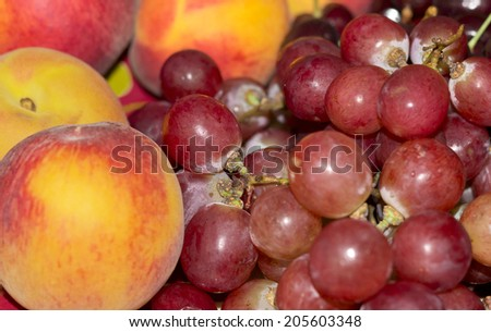 Fruits - grapes and fresh peaches - celebration