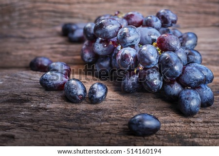 Fruits healthy and useful  Red grapes on wooden background.Selective focus.