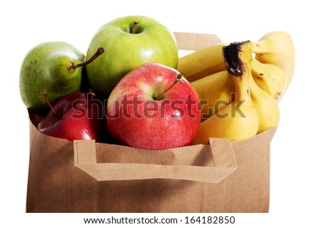Fruits in a paper bag. Isolated on white. - stock photo