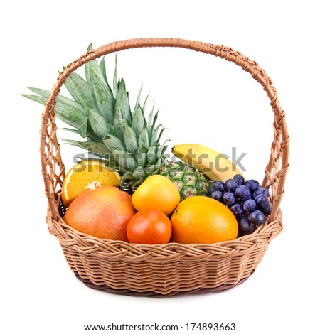 fruits  in a wicker basket isolated on white background