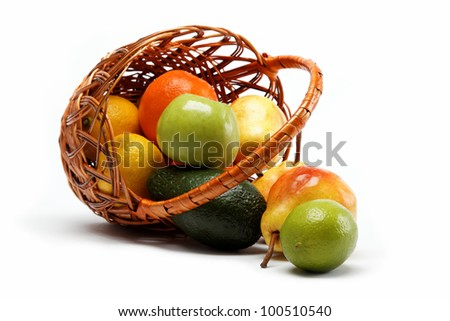 fruits in basket isolated on a white background. - stock photo